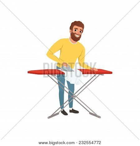 Smiling Man Ironing Clothes On An Ironing Board. Cartoon Character Of House Husband. Young Guy In Ye
