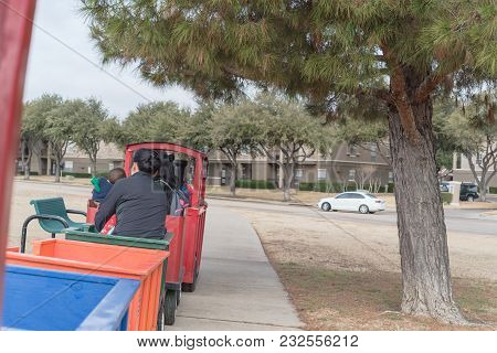 Kid Trackless Train Ride In Public Winter Event In Irving, Texas, Usa