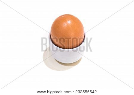 Boiled Egg In Cup Isolated On White Background