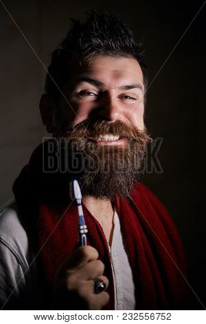 Portrait Of Happy Bearded Man With Toothbrush Cleaning Teeth, Brushing The Teeth In The Morning. The