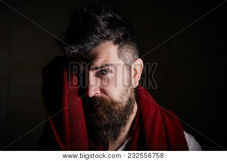 Portrait Of Confident Handsome Sexual Serious Bearded Man With Trendy Hairdo, Using A Red Towel To W