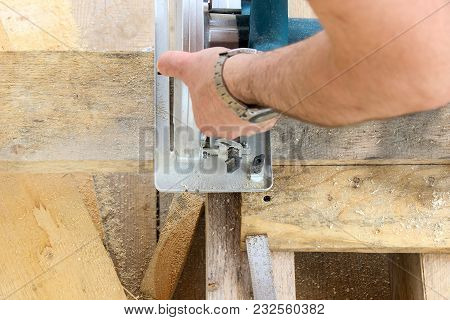 Construction Of A Wooden Frame House - Cutting A Circular Saw With Boards