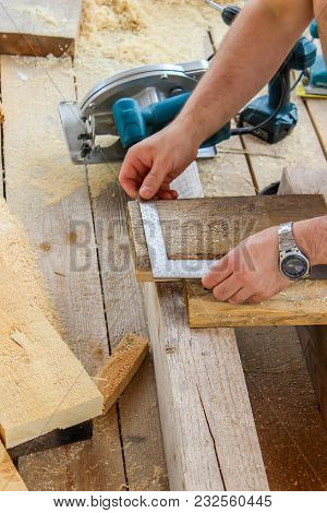 Construction Of A Wooden Frame House - Measuring The Right Size Of The Board, Cutting Off The Saw Bl