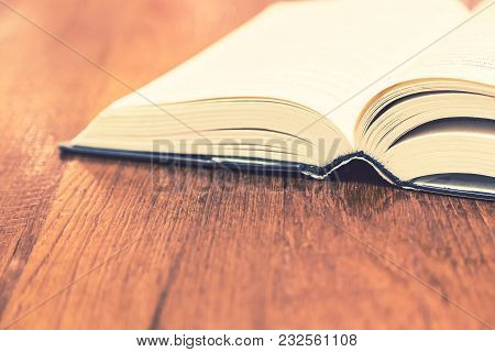 Old Thick Hard Cover Book On Wooden Table, Room For Text Or Copyspace, Selective Focus