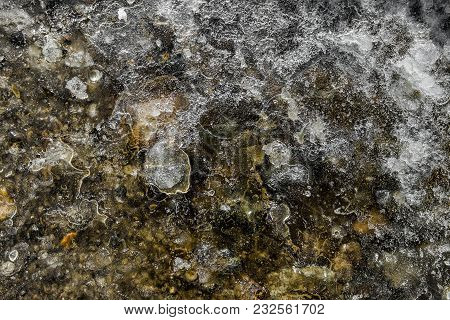Ground Under The Ice. Spring Ice Surface. Thin Ice Texture. The Texture Of The Ice. Natural Backgrou