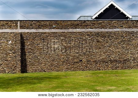 View Of The Picturesque Stone Wall Of The Outlet In Batavia, The Netherlands
