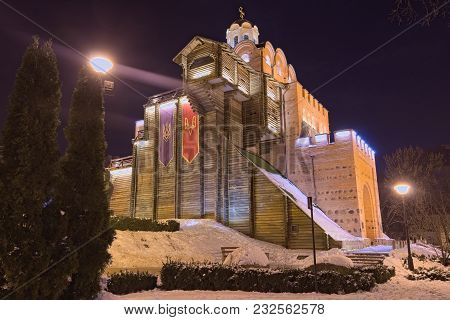 Illuminated Golden Gate At Winter Night. This Gate Was The Main Entrance To The Kyiv City In The 11t