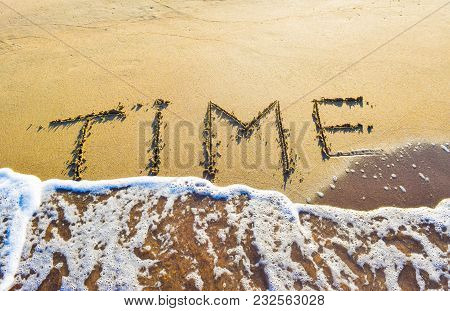 The Inscription Time On Sand Beach On The Background Of Soft Sea Wave.