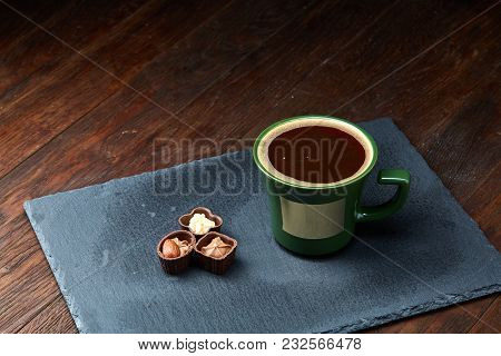 Coffee Cup And Chocolate Candies On Stone Board Over Wooden Background, Selective Focus, Close-up. S