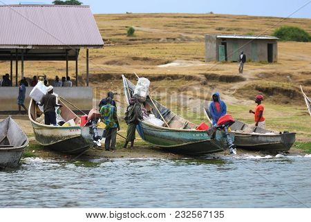Kazinga, Uganda - Aug 29, 2010: Local People Shown On The Kazinga Channel Shore At Twilight. The Kaz