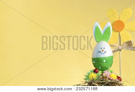 Decorative Easter Decorations On A Stick, On A Yellow Background