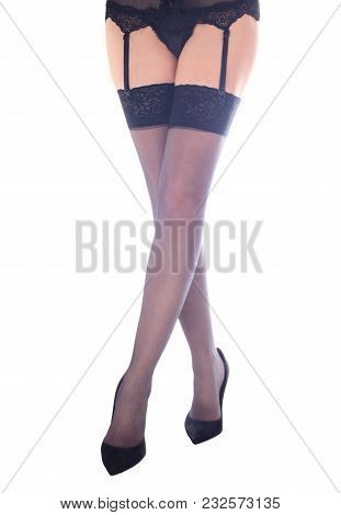 Woman Legs Isolated On White Background. Sexy Woman Legs In Dotted Pantyhose And Black.