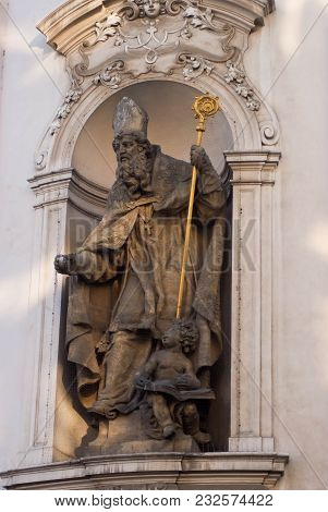 Figure Of A Catholic Bishop In A Niche On The Facade Of A Building