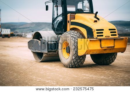 Vibratory Soil Compactor During Roadworks And Highway Construction. Industrial Construction Site  Wi
