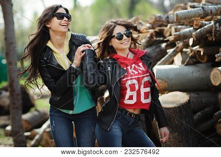 Two Pretty And Happy Young Woman Fave Fun In The Park. Best Friends