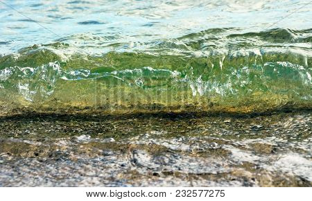 Soft Wave Rolling Onto Beach At Eye Level
