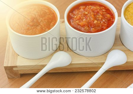 Homemade Sauces And Barbecue Sauce In White Bowls