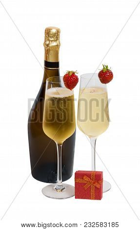 Two Glasses Of Champagne, Bottle Of Champagne And Red Gift Box Isolated On White Background