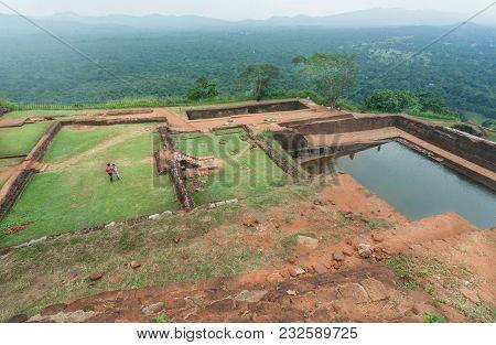 Sigiriya, Sri Lanka - Jan 9, 2018: Couple Of Tourists Watching Ruins Of The Ancient Sigiriya City Wi