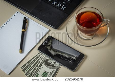 A Table Of A Successful Businessman With Dollars And Gadgets