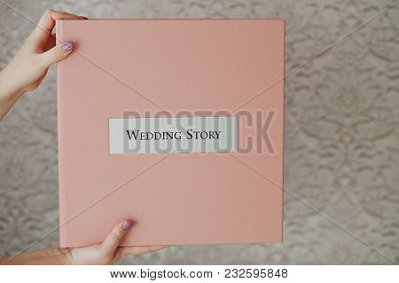 Female Hands Holding Gentle Pink Wedding Box With Photobook Or Photo Album Inside.
