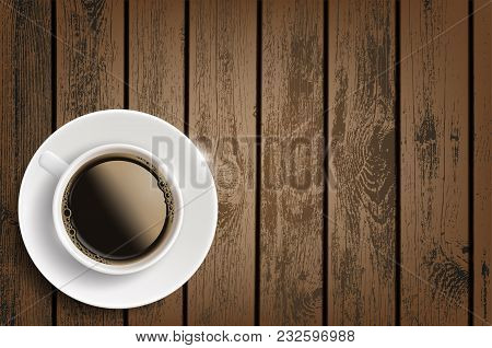 Cup Of Coffee On A Wooden Table. Invigorating Drink. Background For Advertising With Copy Space. Sto