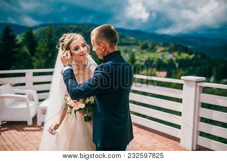 Bride And Groom In Carpathians, Mountains, Beautiful Nature, Landscape, Scenery. Newlyweds At Mounta
