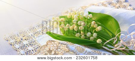 Lily Of The Valley Bouquet On The Table With The Cloth Napkins.