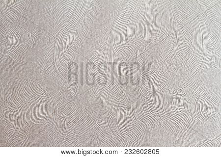 Horizontal Front View Of Flat White Paper Texture With Embossed Curly Ornament