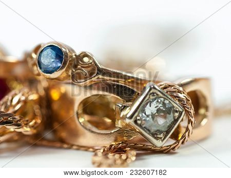 Real Gold Rings With Blue Gem , Gold Chain Isolated On White Background.