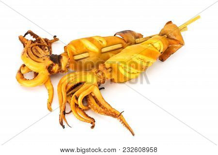 Grilled Squid On Stick, Close Up Of Asian Snack On White Background