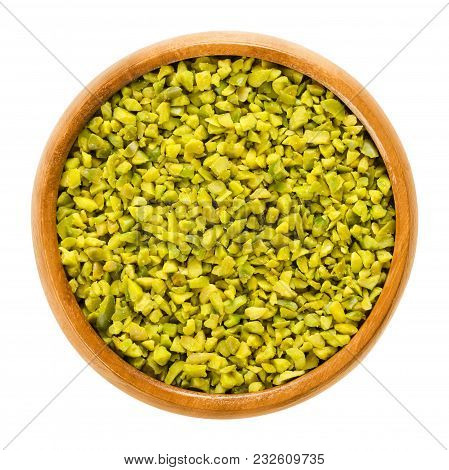 Chopped Green Pistachios In Wooden Bowl. Dried And Peeled Kernels. Shelled Fruits And Seeds Of Pista