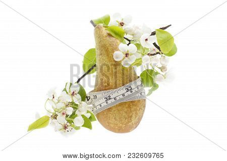 Green Pear With Leaf And Measurement Tape. Juicy Pear With A Twig Of Pear Blossom.