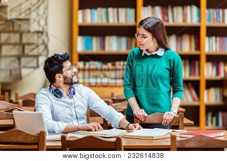 Students Girl And Boy Have Smart Conversation In The Library