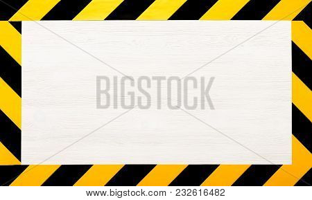 Under Construction Concept Background. Warning Tape Frame On White Wooden Surface Background With Co