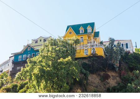 View On Cityscape Of Historical City Valparaiso, Chile. The Colorful Houses And Hectic Street In Val