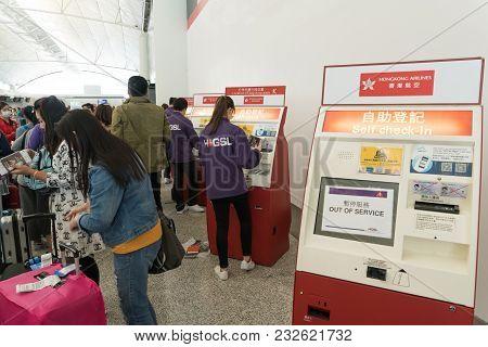 Hong Kong, China - March 19, 2018: Staff Of Hong Kong International Airport Helping Passenger For Ch