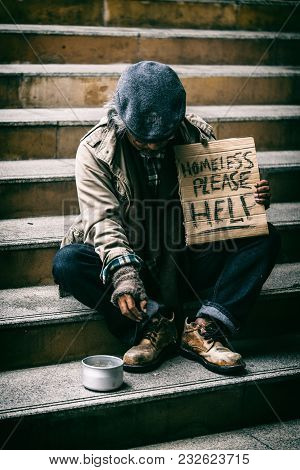 Homeless People On The Street Ask For Help And Money.