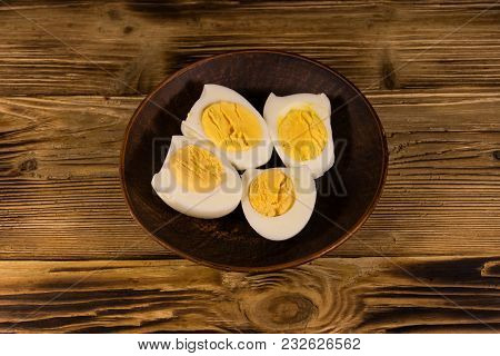 Boiled Eggs On A Plate On Wooden Table