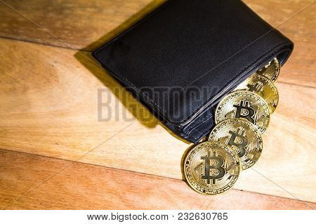 Conceptual Cryptocurrency Bitcoin With Wallet On Table