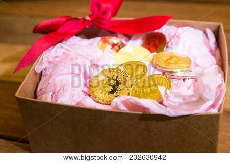 Conceptual Cryptocurrency Bitcoin In Present Gift Box