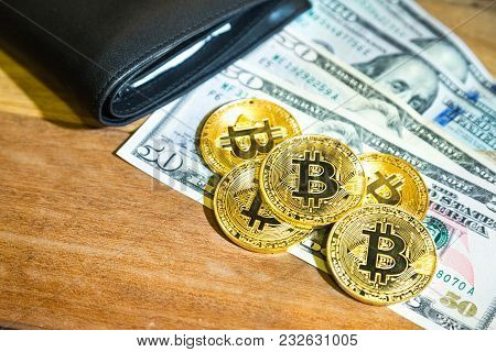 Conceptual Cryptocurrency Bitcoin With Wallet On Table With Us Dollar