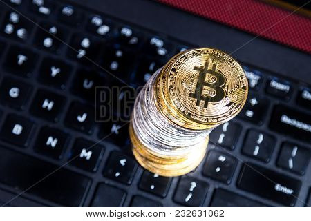 Stack Of Conceptual Cryptocurrency Bitcoin On Computer Keyboard