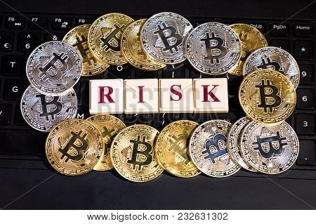 Conceptual Cryptocurrency Bitcoin On Computer Keyboard Word Risk