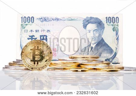 Stack Of Conceptual Cryptocurrency Bitcoin With Japanese Yen Bill Background