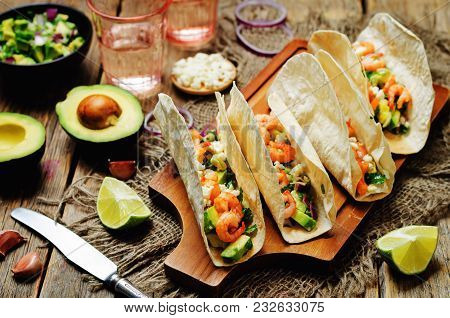 Shrimp Tacos With Avocado Salsa On Wood Background