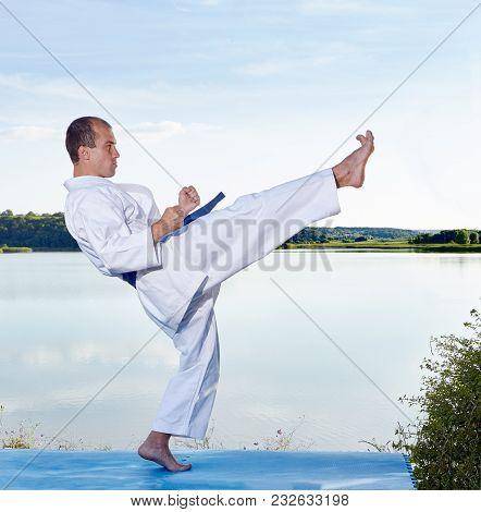 Adult Athlete Hits A Kick Leg On The Lake