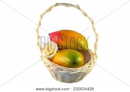 Two Red And Yellow Mangoes In A Basket On White Isolated Background. Ripe Fruit. Beautiful Exotic Fr