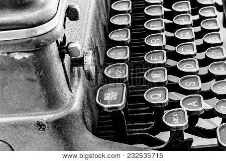 Antique Typewriter - An Antique Typewriter Showing Traditional Qwerty Keys