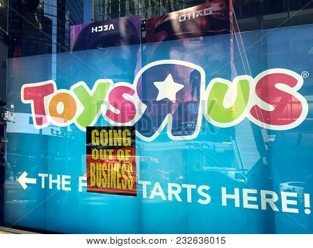 NEW YORK CITY - MARCH 23 2018: Going Out of Business sign in the window of a Toys R Us store in Times Square, NYC. Toys R Us filed for bankruptcy and has started liquidating all US stores.